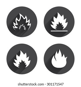 Fire flame icons. Heat symbols. Inflammable signs. Circles buttons with long flat shadow. Vector
