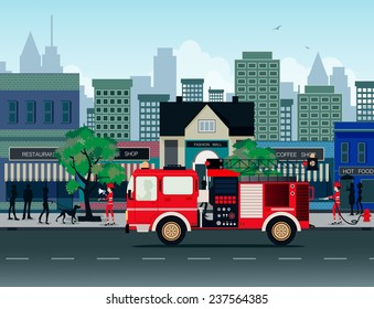 Fire trucks with the city as a backdrop.