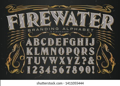 Firewater branding alphabet is a heavily stylized serif capitals font with zig zag lines reminiscent of flames. Ideal set of graphics and letters for alcohol branding.