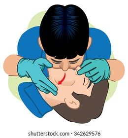 First Aid resuscitation (CPR), mouth-to-mouth resuscitation. Caucasian with gloves. For resuscitation. Ideal for training materials, catalogs and institutional