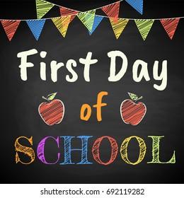 First Day of School. Chalk text on blackboard.