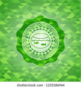 fishbowl with fish icon inside green emblem with mosaic ecological style background
