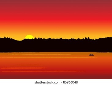 Fishing boat on the lake at sunset (sunrise)