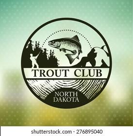 Fishing emblem on blur background