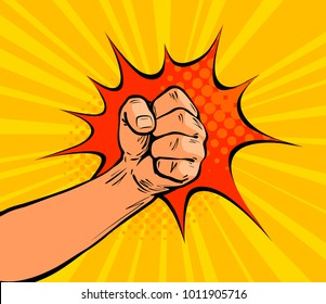 Fist punching, crushing blow or strong punch drawn in pop art retro comic style. Cartoon vector illustration
