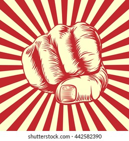Fist punching in a vintage propaganda poster woodcut style