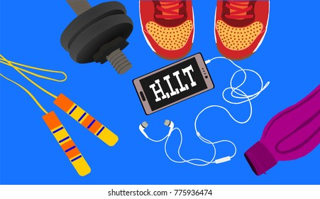 Fitness, healthy and active lifestyles concept. Dumbbells,skipping rope, sport shoes, smart phone with earphone and water bottle on blue background with word hiit (high intensity interval training)