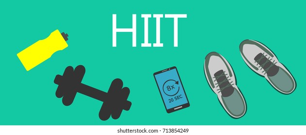 Fitness and healthy lifestyle concept. Sport shoes, smartphone, dumbbell and water bottle with word HIIT