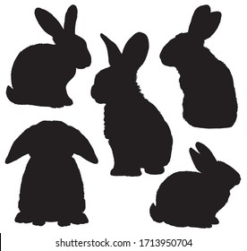 Five black silhouettes of cute rabbits sitting in various poses. Detailed vector Illustrations.