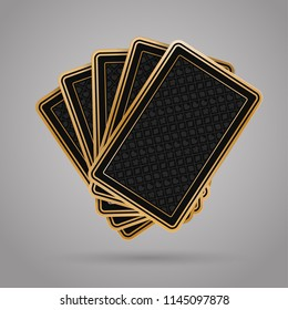 Five closed playing cards on grey background. Black back side design. JPG include isolated path