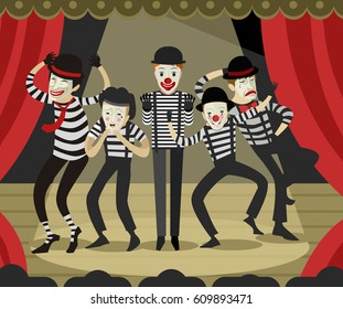 five mime clowns playing actors in theater stage