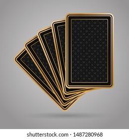 Five poker playing cards on grey background. Black and gold back side design