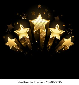 Five shining stars of gold foil on a black background.