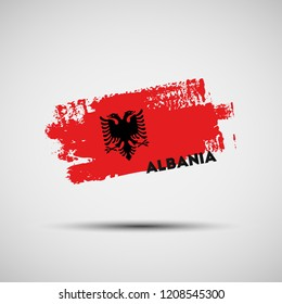 Flag of Albania. Vector illustration of grunge brush stroke with Albanian national flag colors for your graphic and web design
