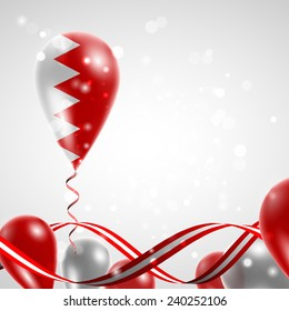 Flag of Bahrain on balloon. Celebration and gifts. Ribbon in the colors are twisted. Balloons on the feast of the national day.