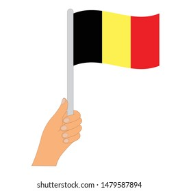 Flag of Belgian  . Hand holding a Belgian flag - vector icon.