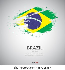 Flag of Brazil with brush stroke or paint on gray background vector illustration