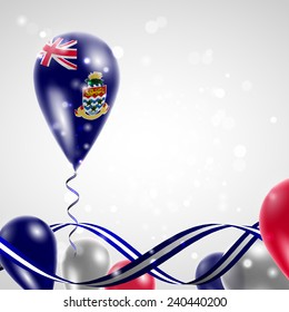 Flag of the Cayman Islands on balloon. Celebration and gifts. Ribbon in the colors are twisted Balloons on the feast of the national day.