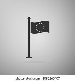 Flag of European Union icon isolated on grey background. EU circle symbol. Waving EU flag on a metallic pole. Flat design. Vector Illustration