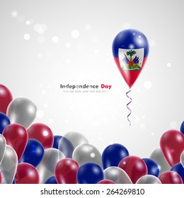 Flag of Haiti on balloon. Celebration and gifts. Balloons on the feast of the national day.