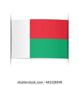 Flag of Madagascar, officially the Republic of Madagascar. Vector illustration of a stylized flag. The slit in the paper with shadows. Element for infographics.