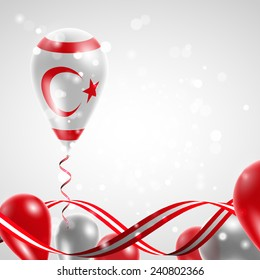 Flag of Northern Cyprus on balloon. Celebration and gifts. Ribbon in the colors are twisted. Balloons on the feast of the national day.