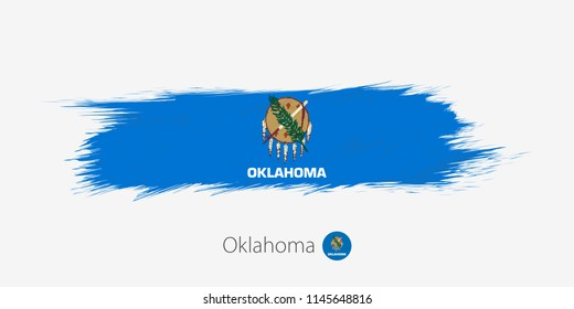 Flag of Oklahoma US State, grunge abstract brush stroke on gray background.Vector illustration.