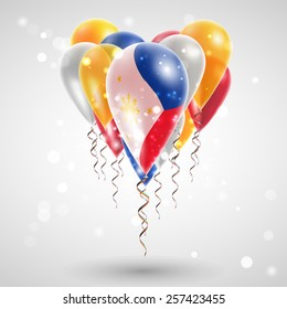 The flag of the Philippines on air balls in heart-shaped. Celebration and gifts. Ribbon in the colors are twisted under the balloon. Independence Day. Balloons on feast of the national