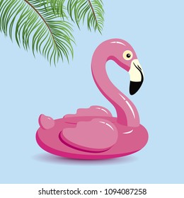Flamingo inflatable and tropical leaves on blue background minimal summer