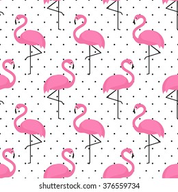 Flamingo seamless pattern on polka dots background. Flamingo vector background design for fabric and decor.