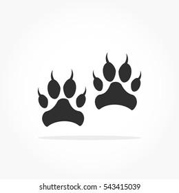 flat black animal footprints with drop shadow, lion or tiger feet mark