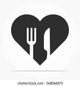 flat black love shape with missing pieces of a fork and a knife shapes with shadow effect