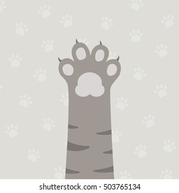 flat brown cat's leg with gray paw and gray paws pattern background