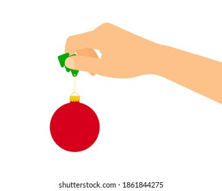 Flat design illustration of a female or male hand holding a red Christmas ornament. Isolated on white background - vector