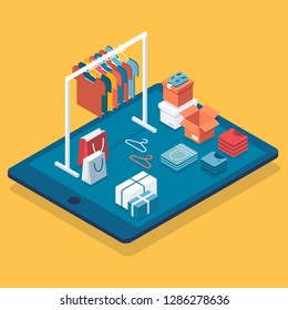 Flat design isometric online shopping e-commerce concept: tablet, boxes, shoes, clothes on hanger and rack, shopping bag.  Boutique, clothing store.Can be used for hero images and web sites and apps