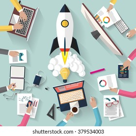 Flat design. top view of team of coworkers working together around a desk.working with laptop and tablet and smarth-phone to launch a new business project and new innovation product on a market.