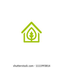 Flat green home with green leaf inside. Simple silhouette of the house with green roof and chimney. Icon isolated on white. Vector building symbol. Eco friendly house. recycle and reuse home sign.