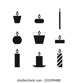 Flat icons Christmas candles isolated on white background. Icons candles set. 9 different candles in flat style. Candles collection. Silhouettes of candles isolated on white background