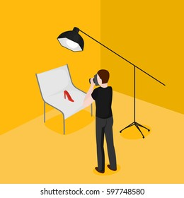 Flat isometric man taking pictures of shoes. Advertising photographer and shooting table in photostudio vector illustration