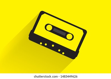 The flat lay cassette with shadow on the yellow background.