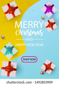 Flat Lay Christmas and Happy New Year or Party Background with Gift boxs, confetti, Present box border on yellow light blue pastel backdrop.