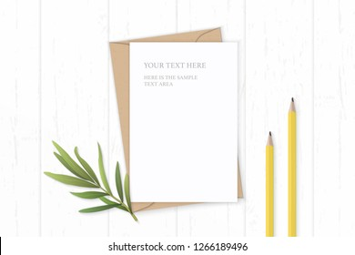 Flat lay top view elegant white composition letter kraft paper envelope yellow pencils and tarragon leaf on wooden background.