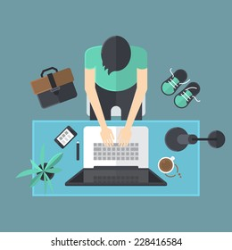 Flat modern design of workspace with man working on laptop computer