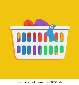 Flat style icon of loundry basket with dirty clothes