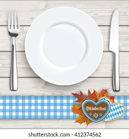 "Flatware and gingerbread with text ""Oktoberfest"" on the wooden background. Eps 10 vector file."