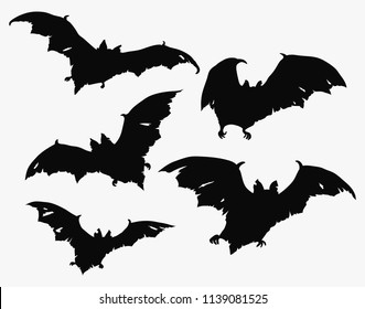 Flock of bats. Set of black silhouettes of bats with torn wings. Collection of bat zombies. Illustration of monsters for the Halloween. Drawing of night creatures. Flying demons. Tattoo.