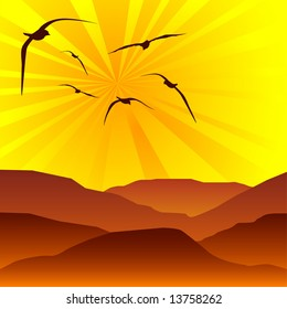 Flock of birds flying into the sun set above rolling hills
