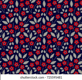 Floral background in vintage style. Decorative embroidery flowers. Vector seamless pattern. Ornament for textiles on blue background. Small red flowers. The elegant the template for fashion prints