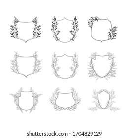 Floral botanical frame and monogram. Vintage border.Vector set of crests.