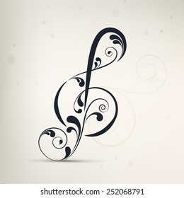 Floral decorated musical sign on stylish light grey background.